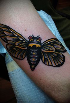 red eyes moth tattoo on bicep. Black Bedroom Furniture Sets. Home Design Ideas