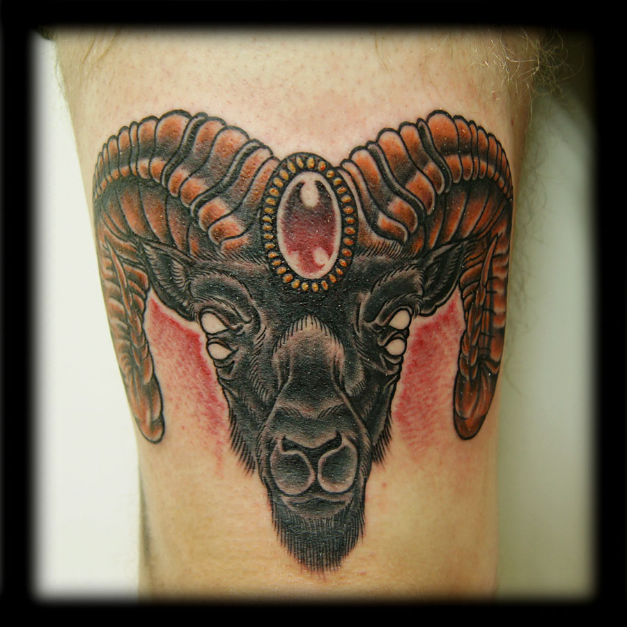 amazing goat head tattoo on biceps. Black Bedroom Furniture Sets. Home Design Ideas