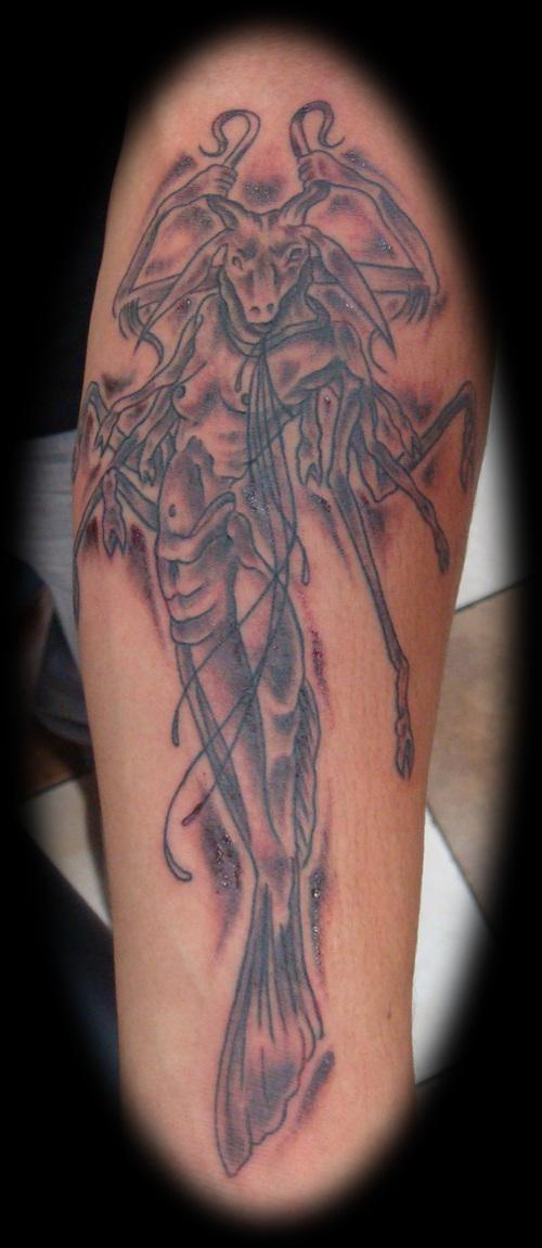 Grey ink capricorn goat tattoo on bicep for Capricorn goat tattoo