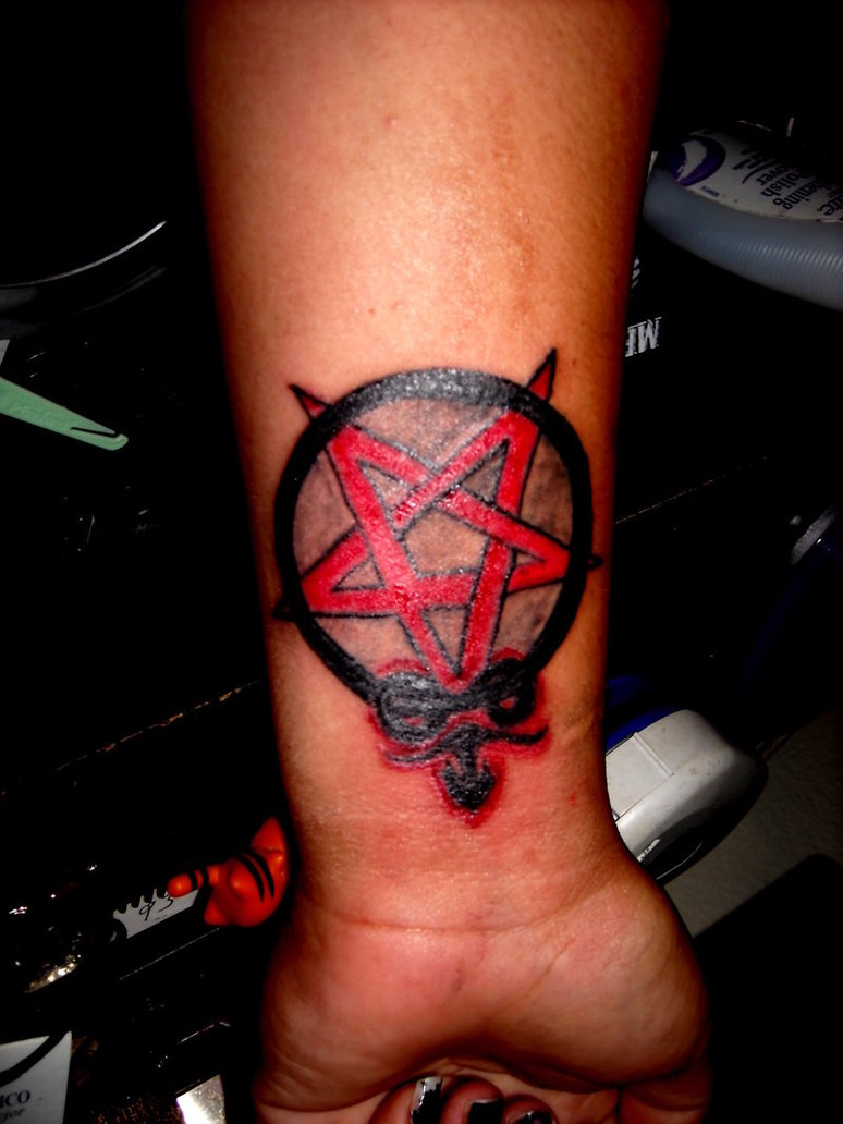 Pentagram And Goat Tattoo On Wrist