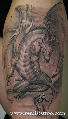 Grey ink dragon tattoo on left thigh for Dragon tattoos on thigh