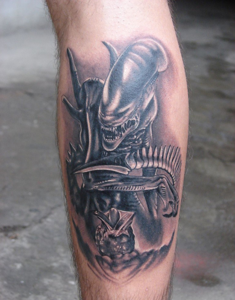 Best grey ink alien tattoo on back leg for Best tattoo ink to use