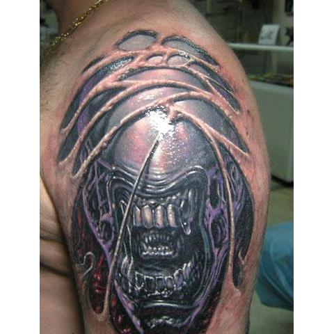 Monster Alien Head Tattoo On Left SHoulder