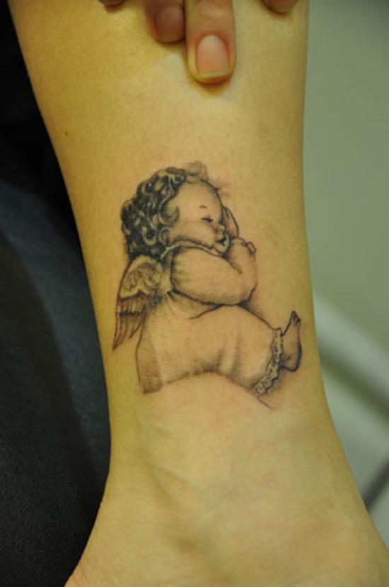 Cute baby angel tattoo on leg for Cute baby tattoos