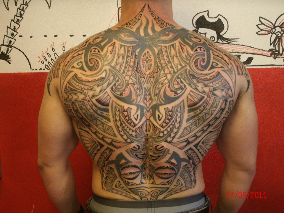 Maori Black Ink Tattoo On Back