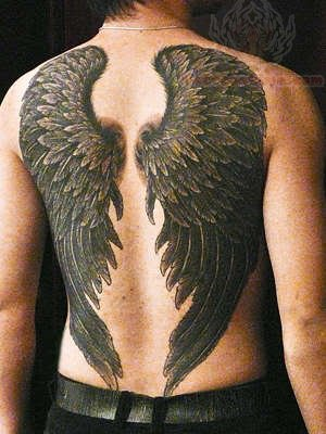 Black ink angel wings tattoo on back for Angel wing tattoos on back