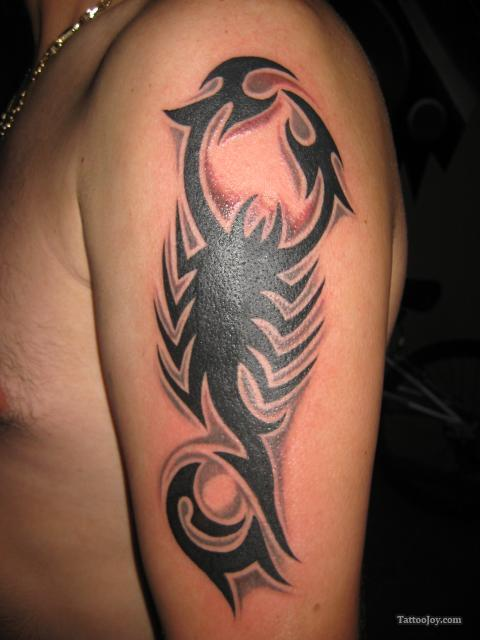 Amazing black ink tribal scorpio tattoo on left half sleeve for Black tribal tattoo ink