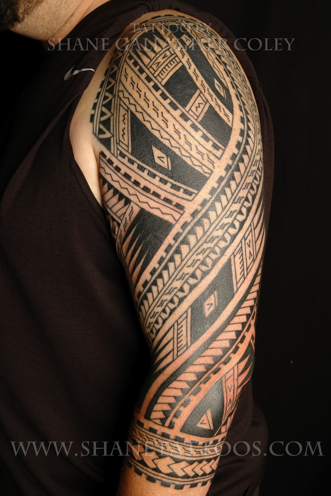 Amazing black ink tribal tattoo on left sleeve for Black tribal tattoo ink