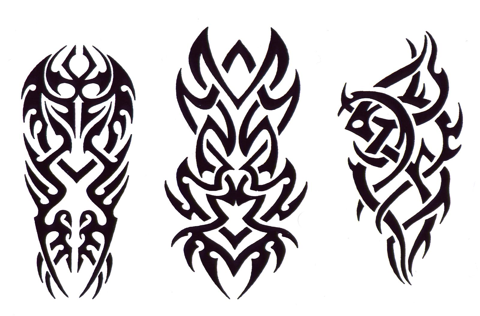 Amazing black ink tribal tattoos designs for Images of tribal tattoos