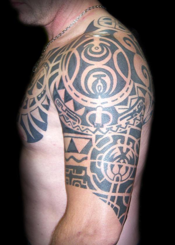Black ink maori tribal tattoo on left half sleeve for Black tribal tattoo ink