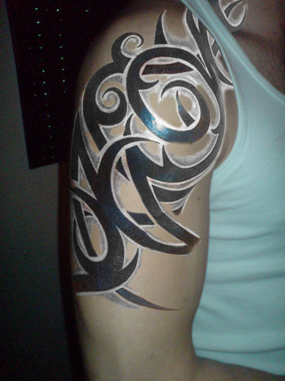 black ink tribal tattoo on man right half sleeve