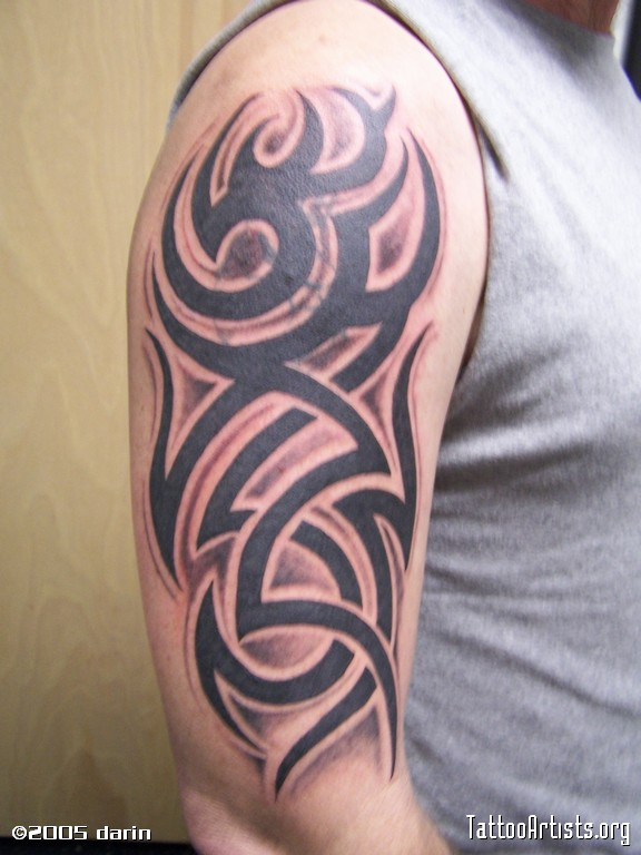Black ink tribal tattoo on right bicep for Black tribal tattoo ink