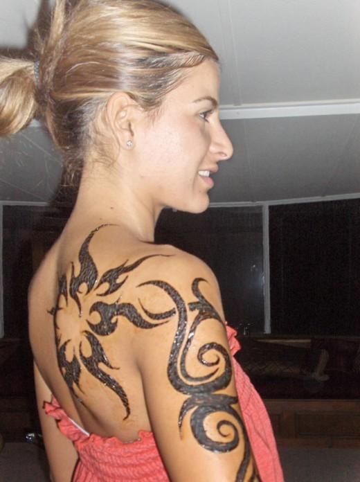 black ink tribal tattoos on half sleeve and back shoulder. Black Bedroom Furniture Sets. Home Design Ideas