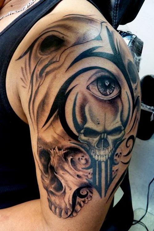 grey ink skull and tribal tattoo on man left shoulder. Black Bedroom Furniture Sets. Home Design Ideas