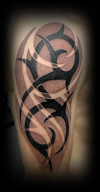 Half sleeve black ink tribal tattoo for men for Black tribal tattoo ink