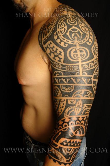 b6eb8b2d5c3fc Man With Tribal Tattoo On Left Sleeve
