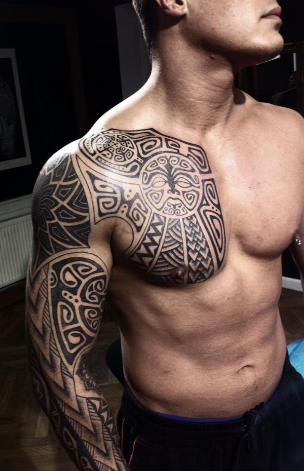 Maori black ink tribal chest and sleeve tattoo for Black tattoo ink