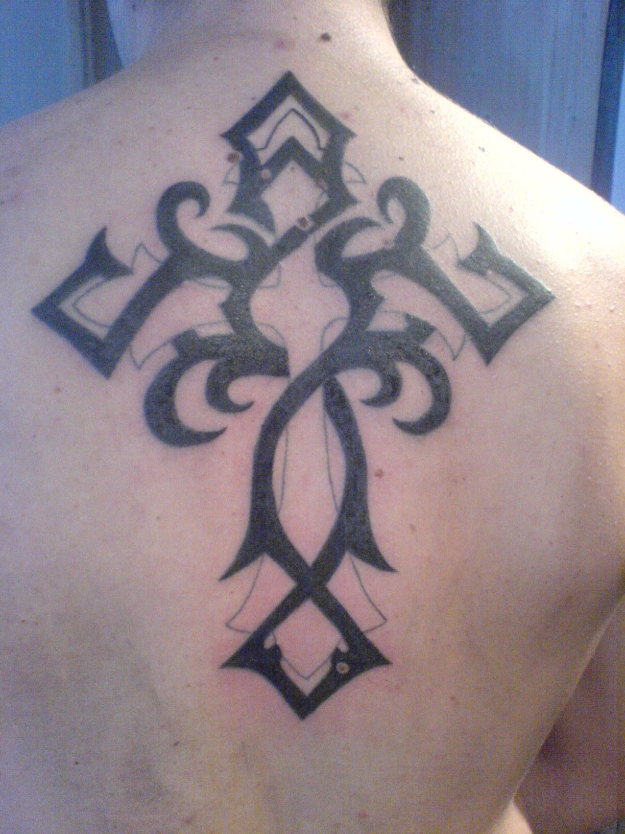 Tribal Cross Black Ink Tattoo On Back