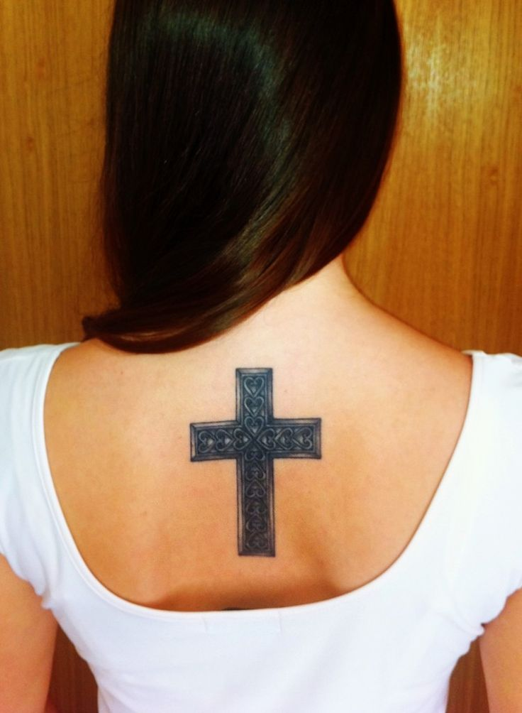 Cross with wings tattoo on back for girls