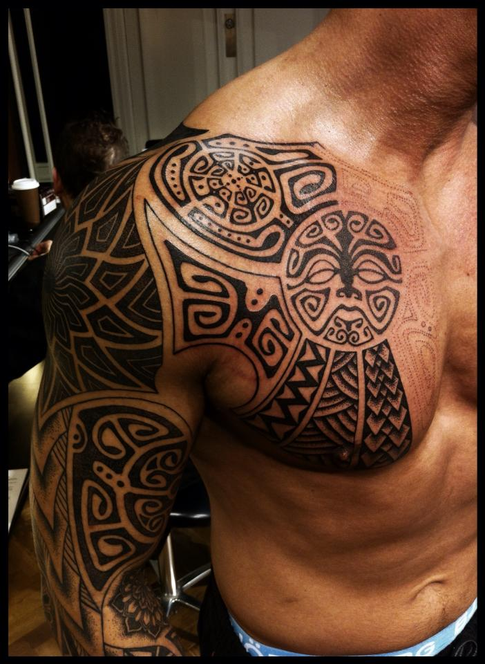 Black Ink Maori Sleeve And Chest Tattoo