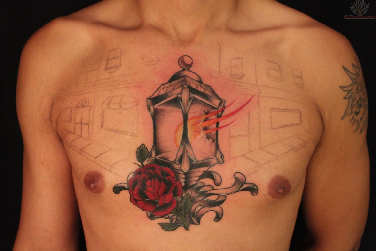Red Rose And Lamp Chest Tattoo