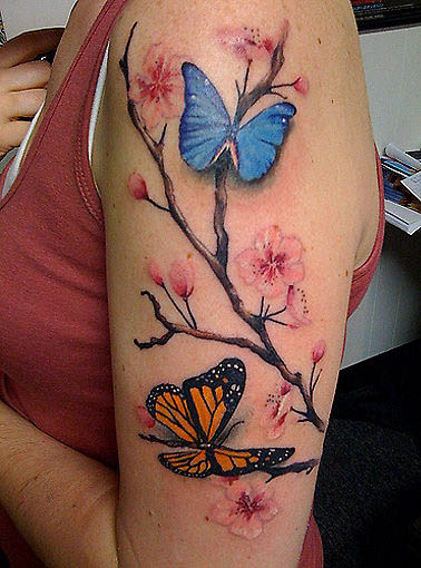 Pink flowers and butterfly tattoos on half sleeve for Flower and butterfly tattoo