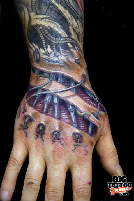 Biomechanical colored ink right arm tattoo for Tattoos on right arm