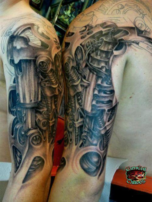 Man half sleeve 3d biomechanical tattoo