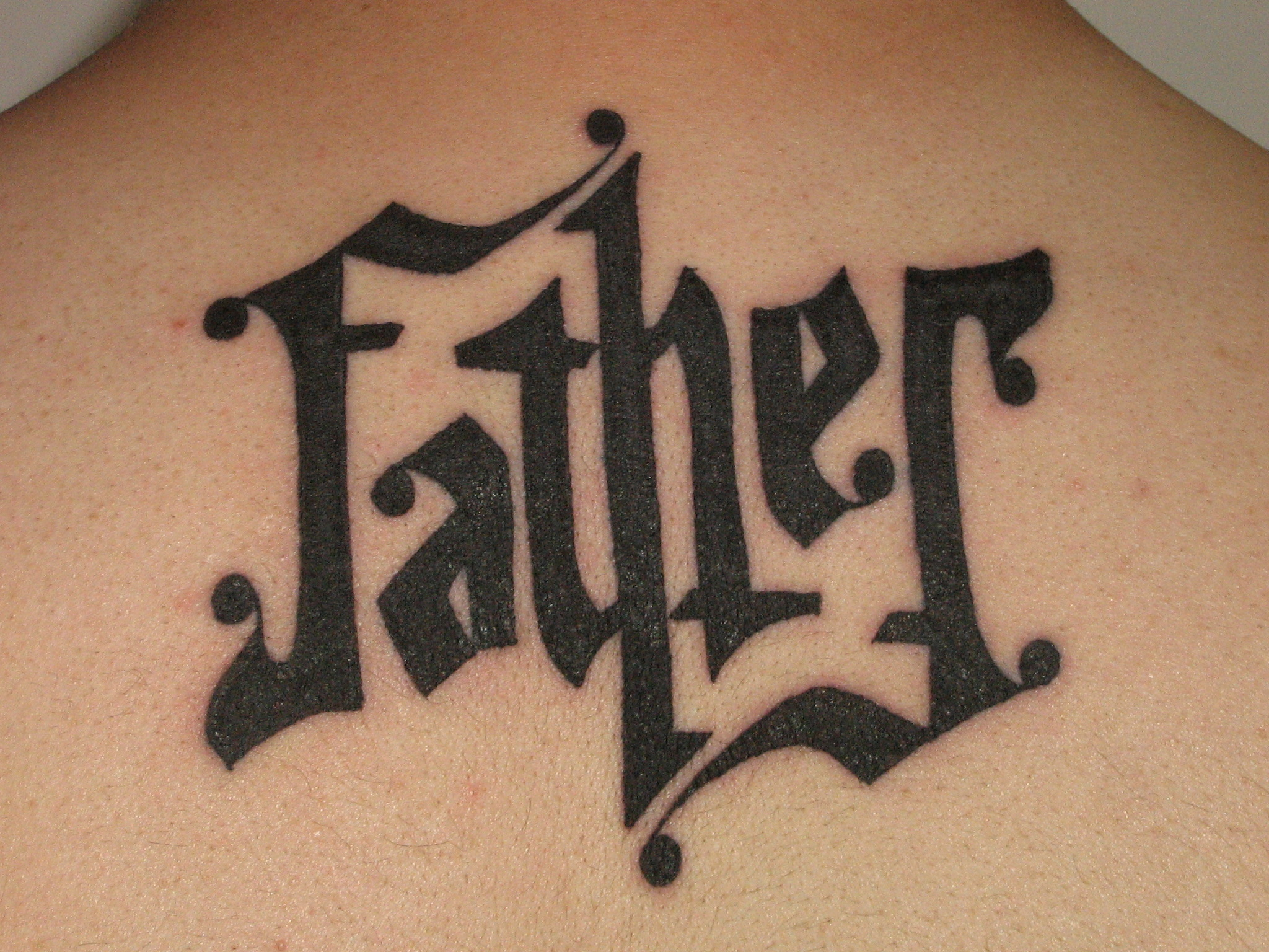 Black ink father ambigram tattoo for Tattoos that say something different upside down