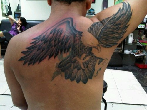 1705235db4eba Amazing Flying Eagle Tattoo On Man Right Back Shoulder