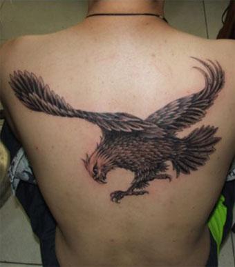 Back body grey ink eagle tattoo for Eagle tattoo on back