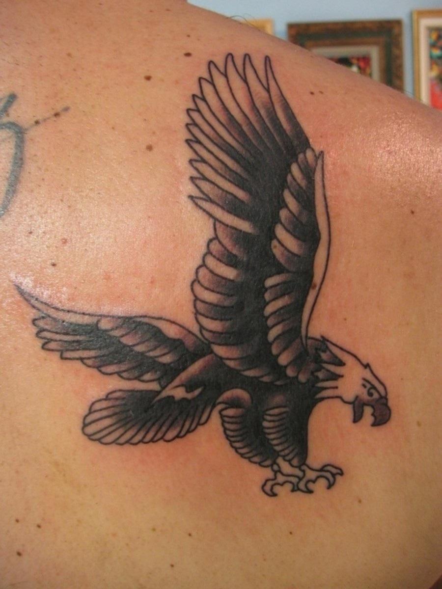 Flying eagle tattoo on right back shoulder for Eagle tattoo on back