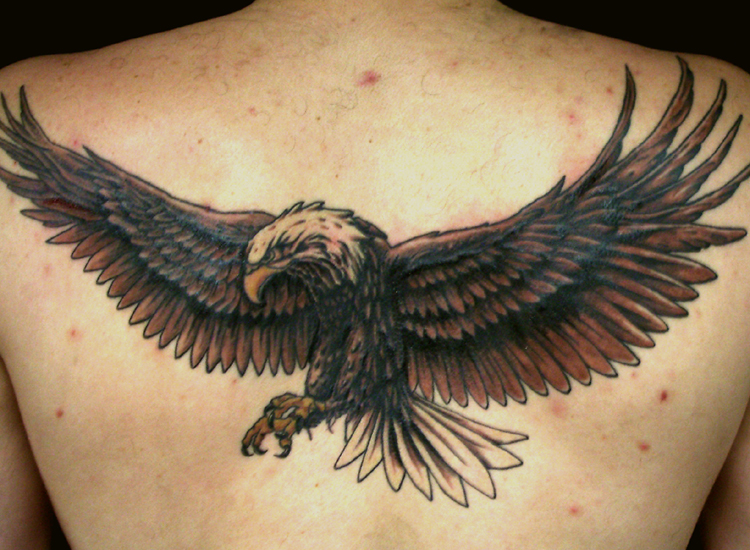 large eagle tattoo on man back body