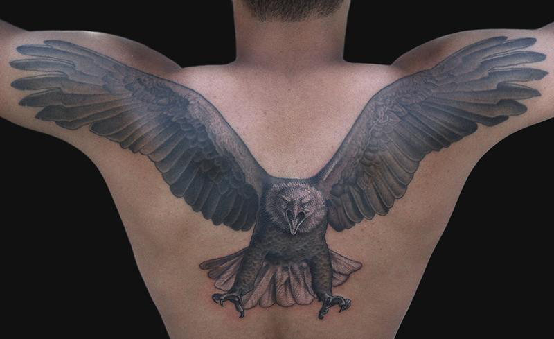 Man with eagle tattoo on upperback for Eagle tattoo on back