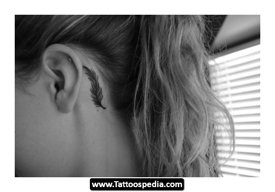 Small Cross Tattoo Behind Ear