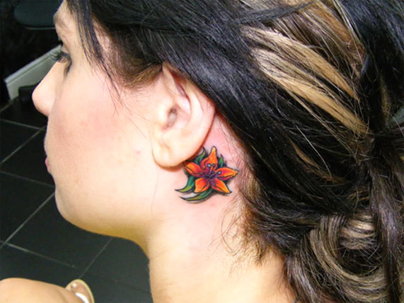 Girl With Flower Behind Ear Tattoo