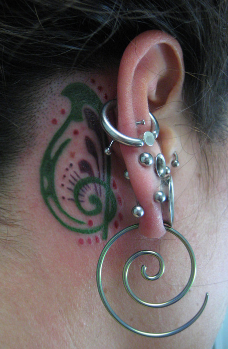 Green Behind Ear Tattoo