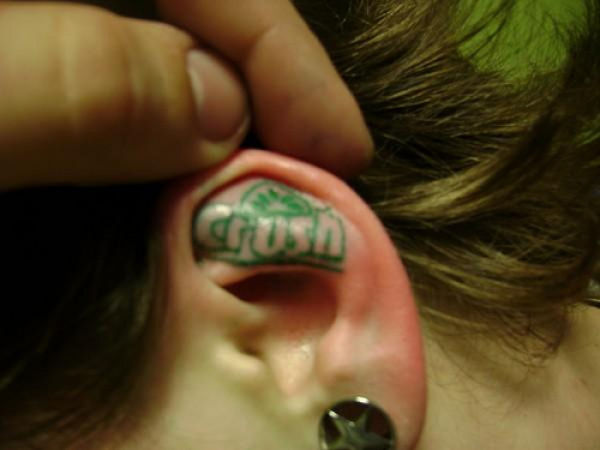 Green Ink Crush Ear Tattoo
