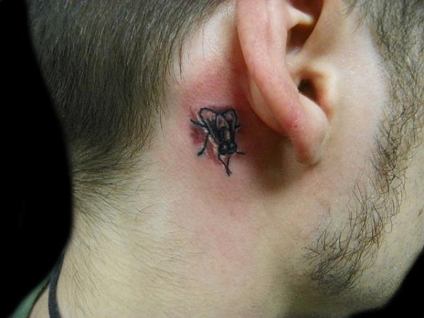Grey Ink Fly Ear Tattoo Behind Ear