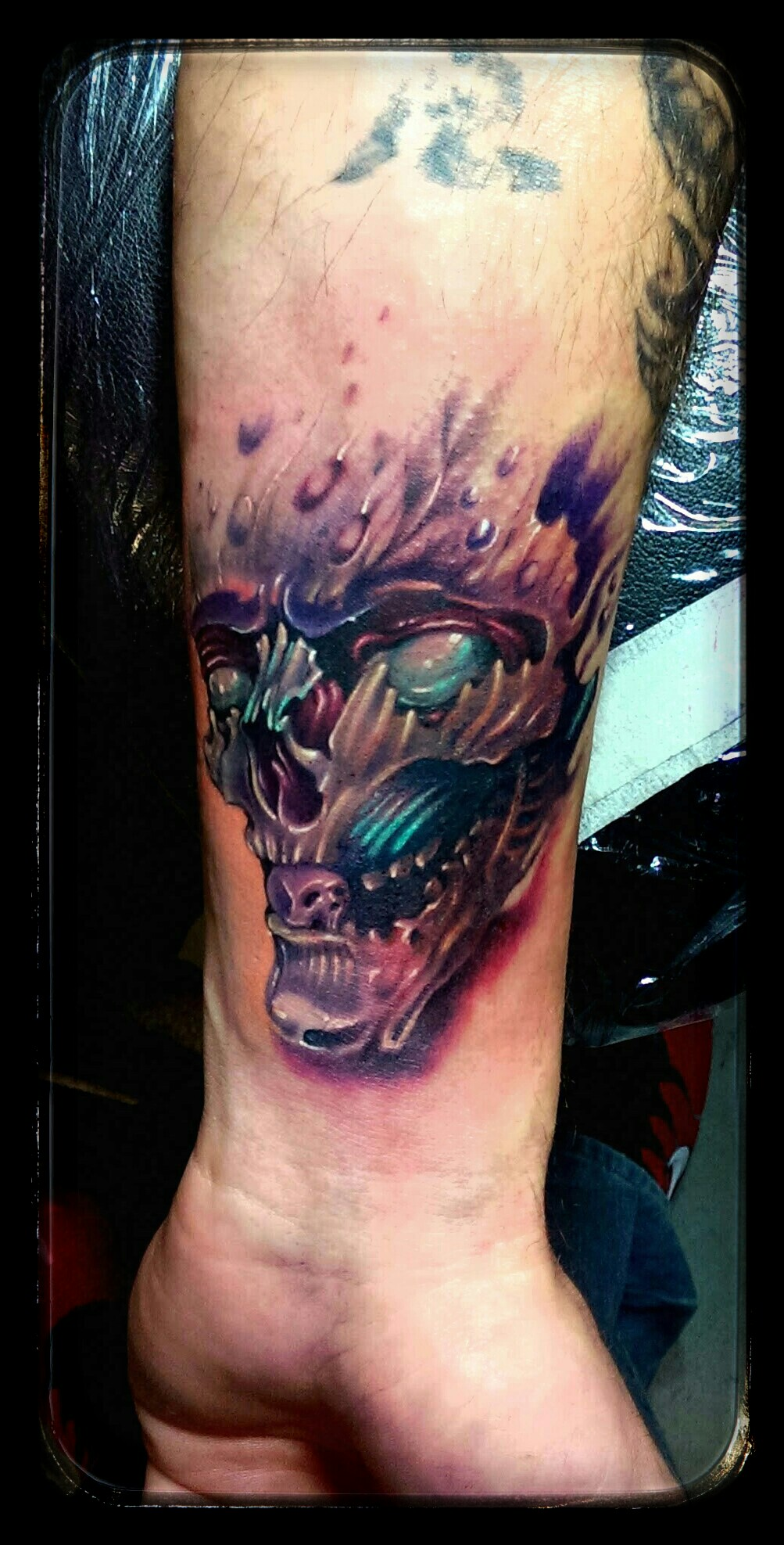 Colored skull tattoo on left forearm for Color skull tattoos