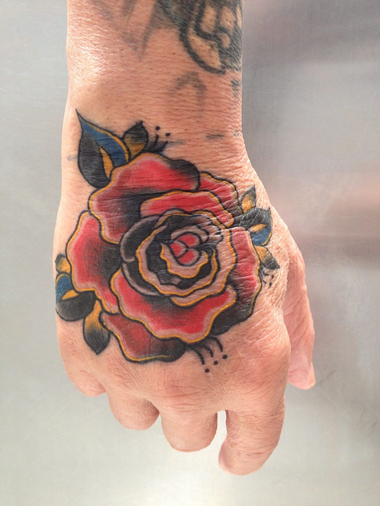 Red Rose Tattoo On Right Hand