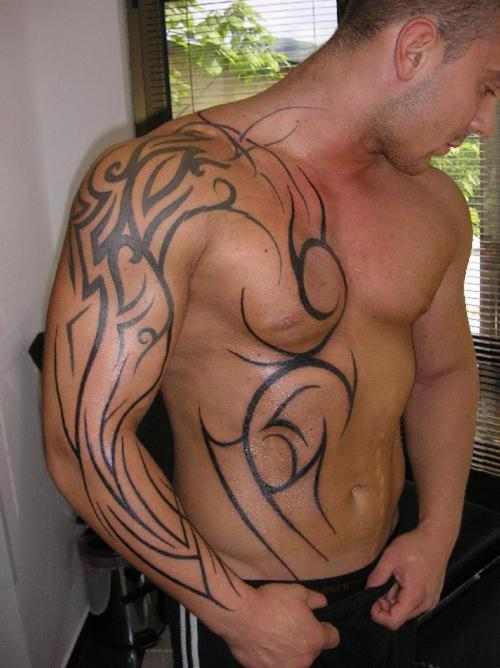 Tribal African Tattoo On Sleeve And Chest
