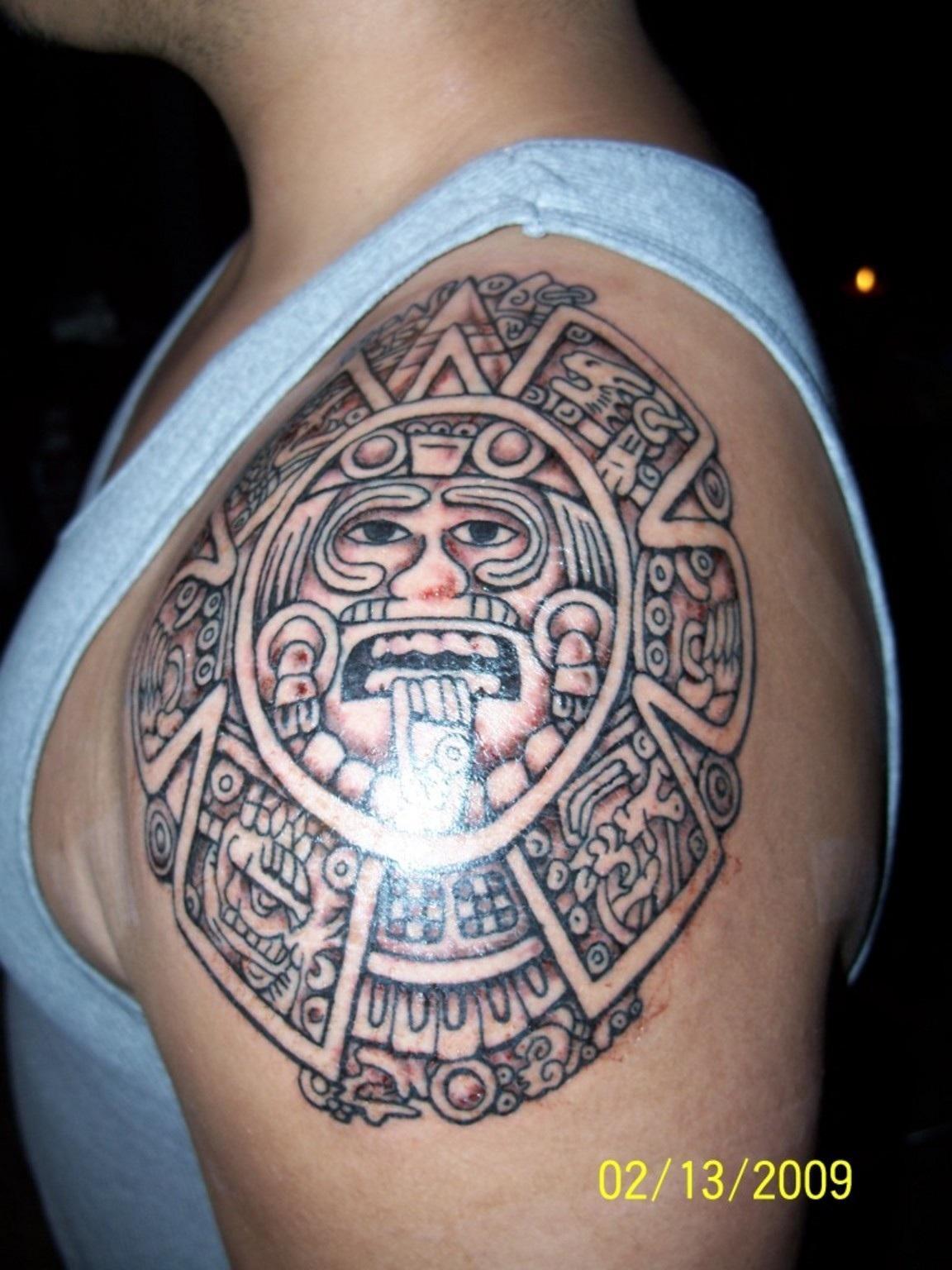 Aztec Sun Tattoo On Man Left Shoulder