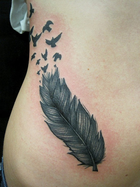 Flying Birds Feather Tattoo On Hip