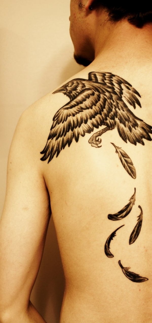flying crow and feathers tattoos on back. Black Bedroom Furniture Sets. Home Design Ideas