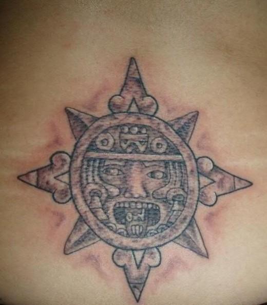 Grey Ink Aztec Sun Tattoo On Lowerback