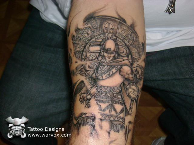 Grey Ink Aztec Warrior Tattoo On Forearm