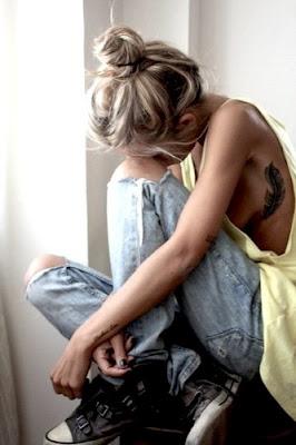 unique girl rib feather tattoo