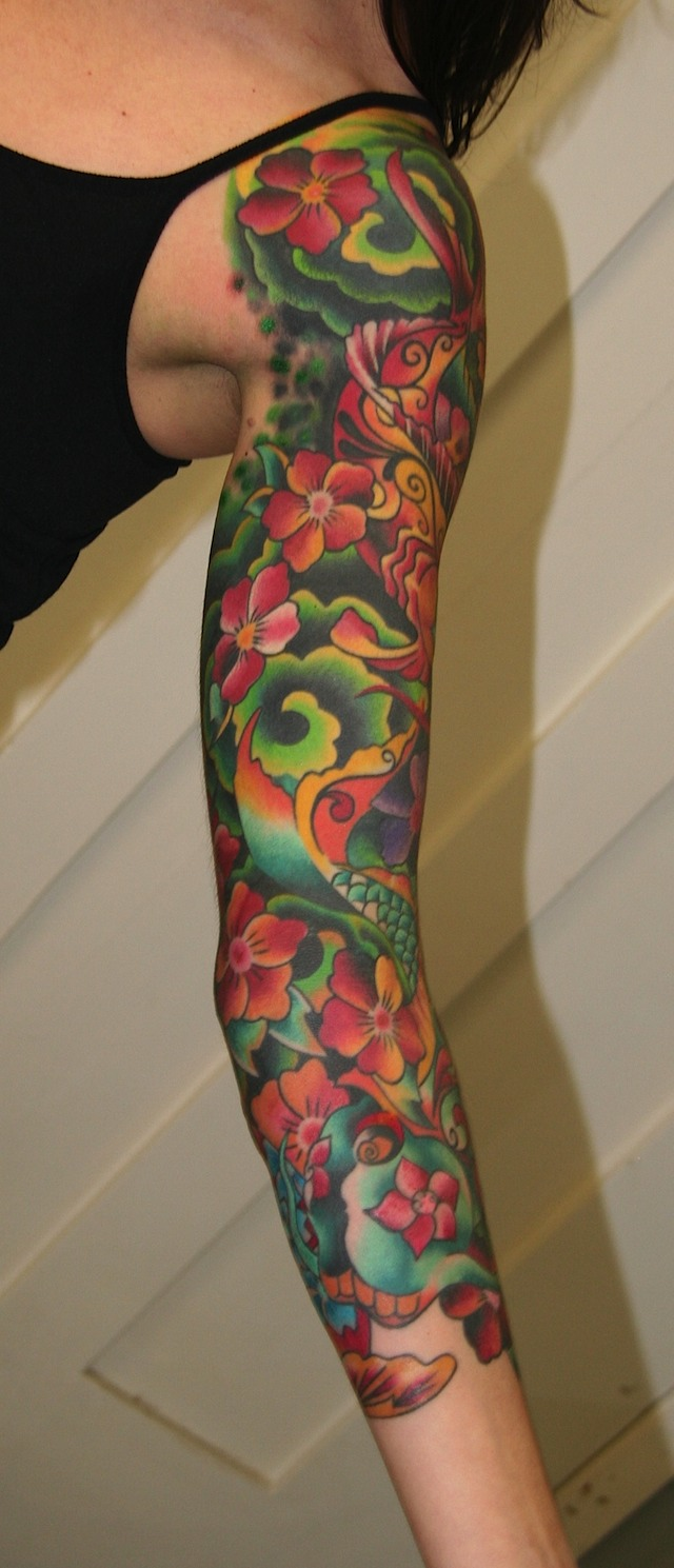 Colored flowers sleeve tattoo for girls for Tattoos for girls flowers