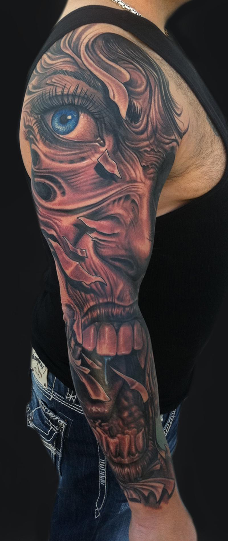 Demon face sleeve tattoo for Evil faces tattoos